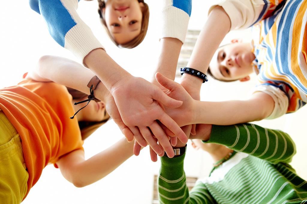 close up pile hands friends 1
