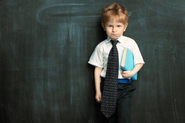 depositphotos 325138956 stock photo schoolboy at the board